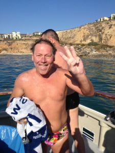 A delighted Roger Finch shows 3 fingers after completing the Catalina Channel swim on Monday, thereby becoming the first South African to achieve the Triple Crown of open water swimming