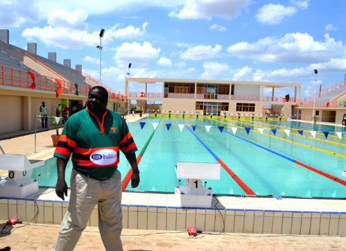 Sports-Minister-Chishimba-Kambwili-pauses-for-a-photo-in-front-of-the-90-days-legacy-swimming-pool