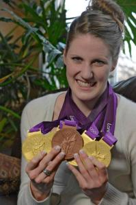 Missy Franklin poses with her Olympic medals. (John Leyba, The Denver Post)