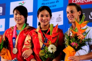 The women's 3m springboard podium: Wang (CHN, silver), He (CHN, gold), Cagnotto (ITA, bronze)