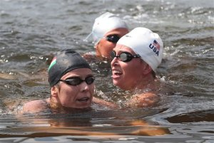 Hungary's Eva Risztova, left, celebrates her win in the Women's 10-kilometer swimming marathon at the 2012 Summer Olympics, Thursday, Aug. 9, 2012, in London. Haley Anderson of the United States is on the right. (AP Photo/Sergei Grits)