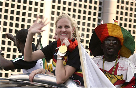 Kirsty Coventry gets a heroes welcome from one of her many winning exploits : image AP
