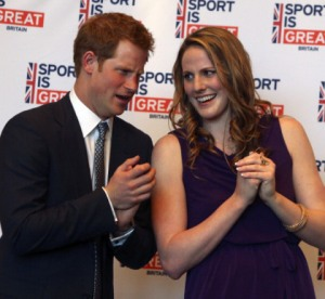HRH Prince Harry (L) talks with Olympic gold medalist Missy Franklin at a reception at the Sanctuary Golf Course on May 10, 2013 in Sedalia, Colorado. (Photo by Ed Andrieski – Pool/Getty Images)