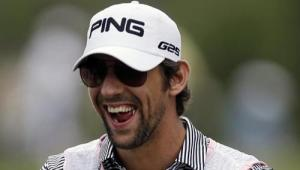 Olympic swimmer Michael Phelps participates in the TOUR Wives Golf Classic, as part of The Players Championship golf tournament at TPC Sawgrass in Ponte Vedra Beach, Fla., on Tuesday, May 7, 2013. Phelps said on Tuesday he was enjoying his retirement from the sport and had no future plans for a return to competition. : PHOTO: AP