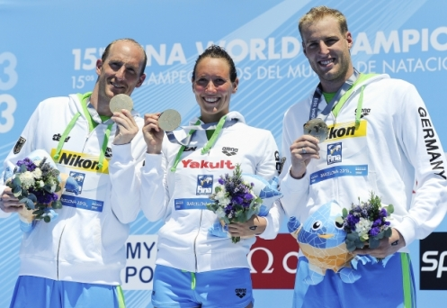 Germany's gold medallists Thomas Peter Lurz (L), Isabelle Franziska Harle (C), and Christian Martin Reichert (R) pose with their medals on the podium during the award ceremony of the team's 5km open water team swimming event in the FINA World Championships on July 25, 2013 in Port Vell in Barcelona. AFP/Getty Images