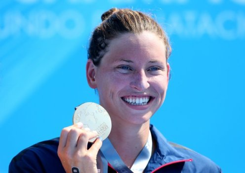 Haley Anderson of USA poses with her gold medal after winning the Open Water Swimming Women's 5k race on day one of the 15th FINA World Championships at Moll de la Fusta on July 20, 2013 in Barcelona, Spain. (Photo by Alexander Hassenstein/Getty Images)