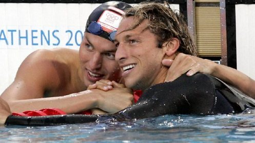 Ian Thorpe and arch rival Pieter van den Hoogenband embrace after Thorpe won Olympic gold in the men's 200m freestyle in Athens in 2004. Picture: Craig Borrow