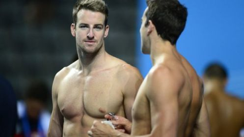 Australian swimmer James Magnussen (L) talks with teammate Matthew Abood during a training session on the eve of the swimming competition at the FINA World Championships, at the Palau Sant Jordi in Barcelona, on July 27, 2013. Magnussen-led Aussie team is seeking redemption for an under-achieving London Olympics, and the tumultuous 12 months which followed. (AFP)