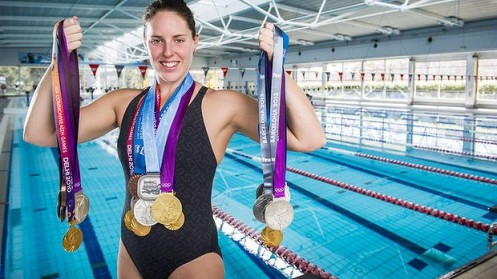 Full medal jacket: Alicia Coutts with the 21 medals she has won over a three-year period of brilliance in the pool. Photo: Rohan Thomson