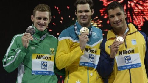 Gold medalist Australia's Christian Sprenger (C), silver medalist South Africa's Cameron Van Der Burgh (L) and bronze medalist Brazil's Felipe Lima celebrate on the podium during the award ceremony of the men's 100m breaststroke event in the FINA World Championships at Palau Sant Jordi in Barcelona, on July 29, 2013. (AFP/File)