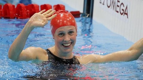 Britain's Hannah Miley smiles after winning a race